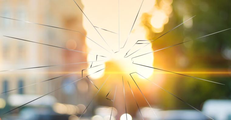 Broken Glass over a Sunrise on a City Scape